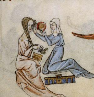 Dama podczas toalety ze służką trzymającą lustro. Angielski manuskrypt z ok. 1325-1335